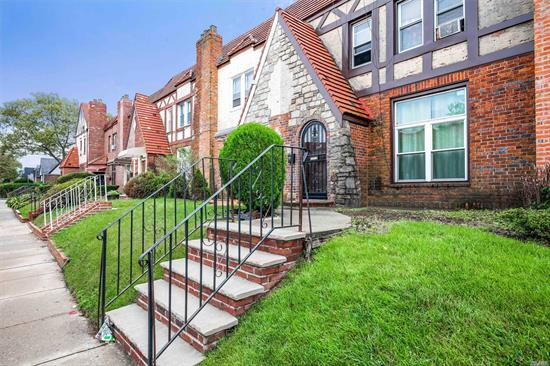 Desirable Attached Tudor Located in Prime Location Of Queens Village. This Tudor Offers 3 Levels Of Living Space With A Huge Living Room, Fireplace, High Ceilings, Formal Dining Room, Eat-In-Kitchen, 3 Bedrooms, 2.5 Baths, Full Basement, Private Backyard & 2 Car Garage. Perfect Opportunity To Renovate!