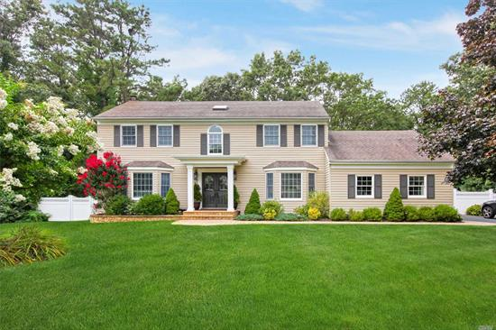 This pristine center hall Colonial is located on a Cul-De-Sac with large fenced, resort style backyard. Solid Oak Plank Flooring with open foyer, remodeled. Baths updated, kitchen with quartz counter tops, CAC, large finished basement with plenty of storage. Taxes w/STAR $11, 611.70