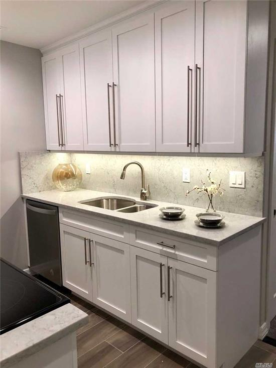 Shaker-style kit/bath cabinets.Quartz ctrtop/backsplash/plank tile flr. Frmls shwr drs.subway tile bath/quartz vanity/basketweave flr tile.Hi-hats.Ceil fans.Whirlpool gold ser stls.stl.appl. WD.Gray paint/crpt.AC units. Close to shops/parks/NUMC. Convenient to parkways. Prices/policies may change w/o notice