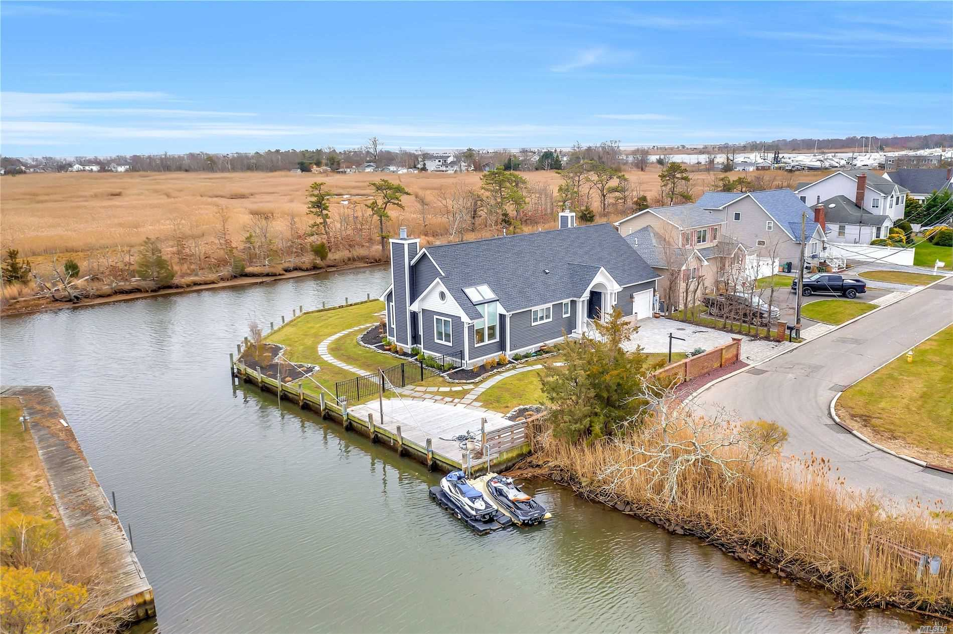 Don't Miss This Spectacular Waterfront Property Tucked Away in the Idle Hour Area with Over 200' of Bulkhead! This Home has Totally Been Updated with Wide Open Floor Plan Great for Entertaining. Water Views from Nearly Every Window, Gleaming Wood Floors, Cathedral Ceilings, Radiant Heat, Living Room w/ Beautiful Stone Fireplace, Kitchen w/ Stainless Steel Appliances and Granite Countertops, Master Bedroom w/ Full Bath and Outside Balcony and Outside Seating w/ Private Views on Canal.