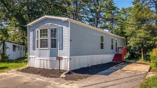 This is a 55 and older Community. 2016 Champion Home. Large eat-in-kitchen, living room. Two bedrooms, 1 1/2 baths.Alarm system , Central A/C. A 6x12 deck. Private driveway.Land Rent, includes tax. $821.Use of Club House, water, trash, snow removal, cesspool maintenance. Ocean access with beach permit. Please no dogs over 45 lbs.