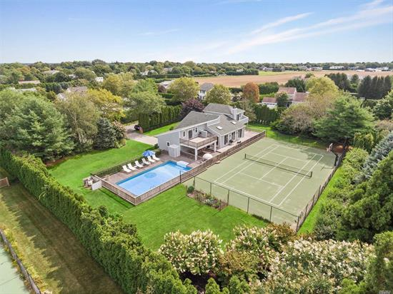 South of the Highway in prestigious Water Mill, Contemporary Home on 0.8 acre offers a fabulous Hamptons retreat close to Southampton Village & ocean beaches. The light-filled home offers approx. 4800 square feet of living space, plus a finished lower level recreation room with home theater & surround sound. 4 Bedrooms, 3.5 Baths, Entertain by the the sunny 20x40 pool surrounded by mahogany decking and also enjoy Tennis and Basketball. Outdoor Shower. Natural Gas. Call for a showing appointment.