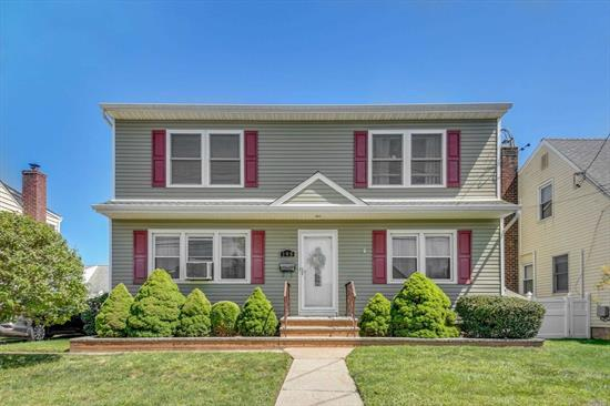 Wonderful 5 bedroom colonial with plenty of room for extended family. Main level has large EIK, Livingrm , 2 bedrooms and full bath. The second floor offers a second master suite with fbath, 2 additional bedrooms, full bath and a 2nd living room. Close to parkways, shops, schools and LIRR. Great house for large extended family