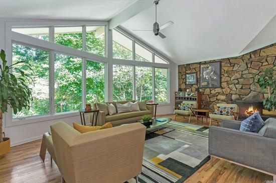Pristine Harbor Acres Custom Contemporary! Nestled into a beautiful 2 acres on a quiet cul-de-sac w an outstanding multi-level pool area & cabana. Enjoy your private oasis through soaring windows that bring the outside in. You'll never want to leave home! Gourmet EIK. FDR w deck overlooking yard. FLR w incredible stone WBFP. Main level master suite w spa bath, 2 addl spacious bedrooms & FB. Lower level den w WBFP, 2 addl bedms & FB. 2 car att garage. Access to private association beach & tennis.