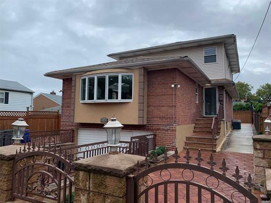 gorgeous renovated 1 family ready to move in! 5 BR + 1MR, wooden floor, brand new lighted kitchen with beautiful granite counter top and sky light . 1st FL has 3BR the MR BR has full bath and walk in closet. 2nd floor has 3BR W/ full bath.  Full finished basement with high ceiling, radiation heated floor installed* 2 exits from the back and from the front.High security doors($4, 000 each). backyard has cement W/ full court basketball and ext roof above basement stairs. house sealed all around.
