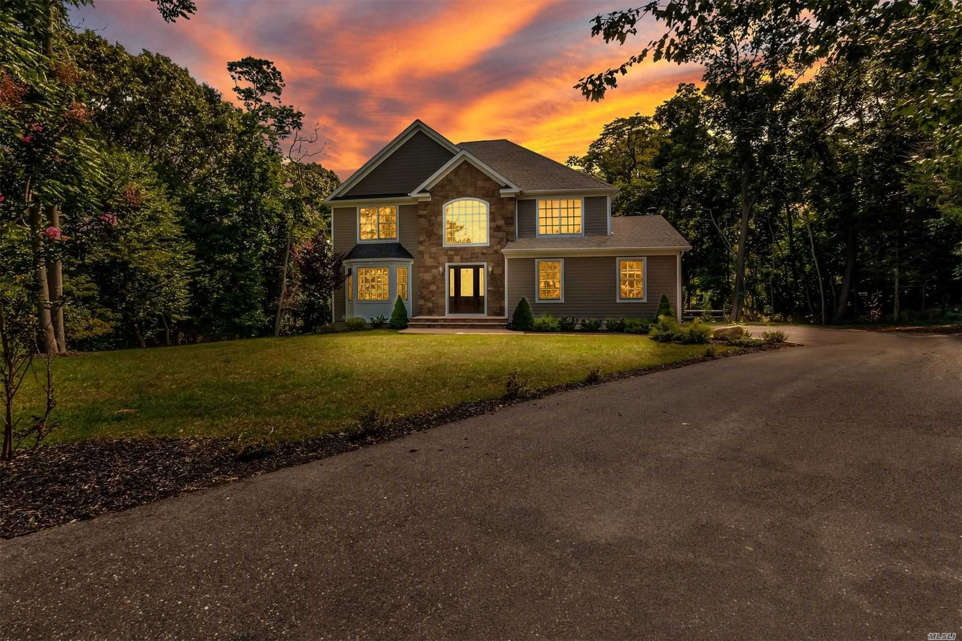 Pristine cul-de-sac home in Crescent on the Sound w/beach rights on 1.19 acres; features den w/fireplace;hardwood floors, oak stairs, Pella windows & doors, high-hats, peerless energy efficient burner;Hardi planked siding;gourmet white kitchen w/top-of-the-line stainless steel appliances, farm sink, granite w/waterfall center island;marble baths, full basement & 2 car garage