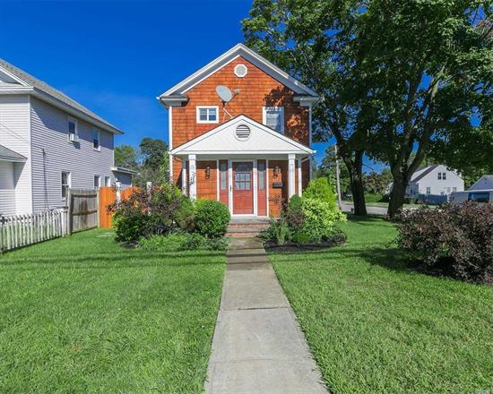 Location, Location, Location! Colonial with True Country Charm! 3 BR's, 2 New Full Baths, New EIK Custom Cabinets, S/S Appliances & Granite, LR w/FP,  Full Finished Basement, all nestled On a Corner lot. Close to Grade School, Village Recreation, Theatre and Restaurants.