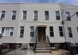 Wonderful Four Family House in Very Good Condition for Sale in Ridgewood. Both First and Second Floors include Two 2BR Apartments with an EIK, LR and Full Bath in each. All Kitchens and Bathrooms have been updated. Convenient to Transportation and Shopping.  Rent Breakdown: 1R $1950, 2R $1300, 1L $1875, 2L $1300. Heat $2736/yr, Water $2880/yr, Electric $540/yr, Ins $3012/yr, NOI $59,256