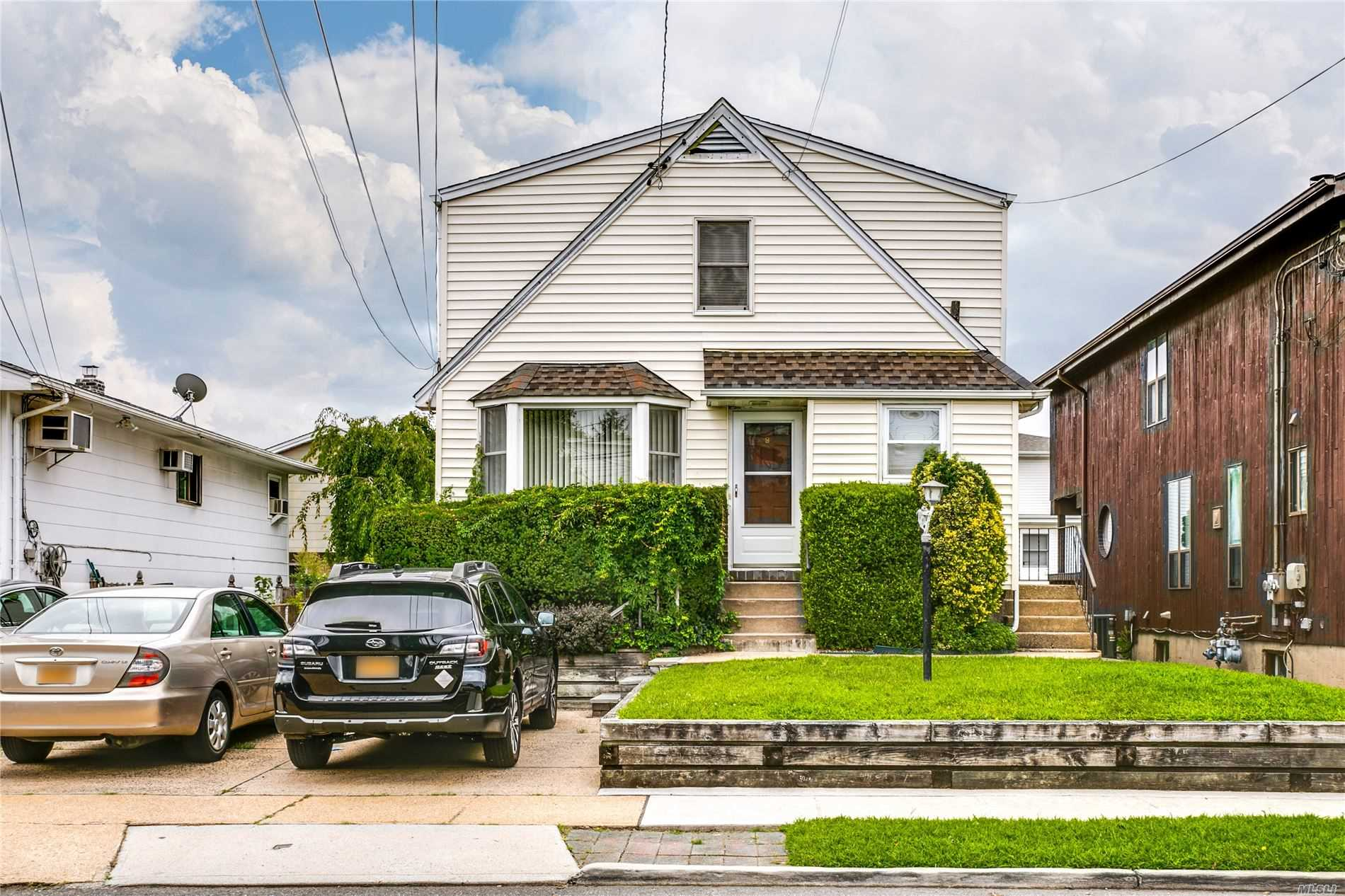 Private side entrance to a sunny 2nd floor 2 bedroom apartment with hardwood floors, kitchen/dining room, living room with built in a/c unit, 2 off street parking spots, heat/hot water/gas included. Close to Manorhaven Park, Beach & Pool. No Laundry. Storage allowed in garage.