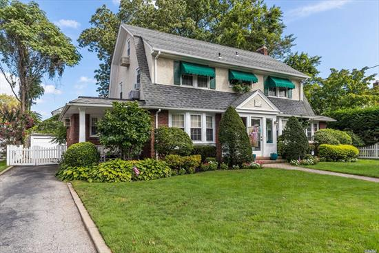 Beautiful Classic Dutch Colonial In The Harvard Section Of Rockville Centre. Enclosed Entry Foyer, Large Formal Living Room with Wood Burning Fireplace, Formal DR with Entrance to Front Porch,  Den, Eat in Kitchen with Granite Counters, Overlooking Sprawling Backyard,  Great Outdoor Entertaining Space. Washer/Dryer First Floor. Master EnSuite,  Bedrooms and Hall Bath, Walk Up Finished Bonus Room with Storage Rooms. Basement Finished, Large Recreation Area with New Gas Boiler,