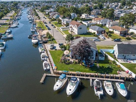 WATERFRONT SAILORS DREAM is HERE!! OPPORTUNITY TO LIVE MORTGAGE FREE IS DOCKING SO PUT YOUR LIFE JACKET ON AND JUMP IN YOU WONT SINK! 210 NAVY BULKHEAD(12 BOAT SLIPS) SURROUNDS THIS CORNER BEAUTY! Home Features a Gorgeous Eat-in-Kitchen, Engineered Hardwood Floors with Radiant Heat Connected to Gas Line, Master Suite with A Balcony AND A Secluded Master Suite with A LOFT for your Summer Guests or Extended Family that just won't leave! Beautiful Bay Window and Front Porch, Views From All Rooms!!