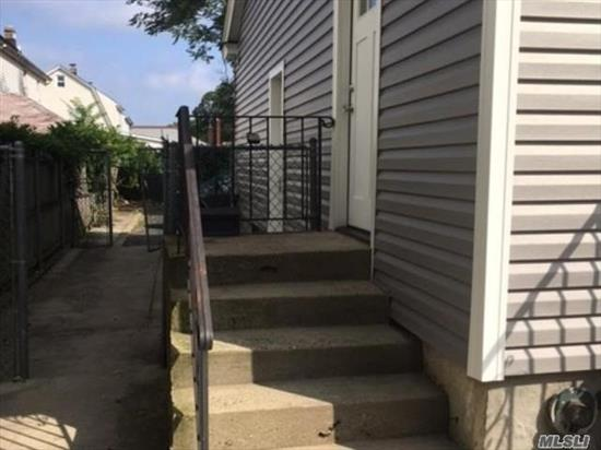 Newly renovated 2nd floor apartment of private house. New roof, siding, kitchen, bath, floors, ceiling fans, paint & carpet. Parking for 1 car only...on premises. Close to L I R R, buses, shopping and schools. Ready September 15th.
