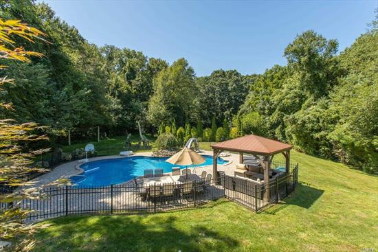Sprawling, 5 Bdrm, 4.5 Bth, Exp & Ren Ranch In Hunting Hill Sect of Woodbury. Open Floor Plan, Wd Flrs, High Ceilings, Spac Rm Size. Fabulous Chef's Kitchen W/Hi-End App: Dble Rnges, Dble Dshwshrs, Sep Fridge & Freezer, & Wine Fridge. Large C I W/Seating Opns to Fam Rm W/ Stne Fplce. Grnd Mstr Suite W/ Sitting Area, & Private Trex Deck. Full Fin WO Bsmnt W/ Enter Area, Full Gym, & Home Office. Possible Accessory Apt W/Proper Permits or Prof Office. Country Club Prop, Htd IG Pool, Tennis Ct