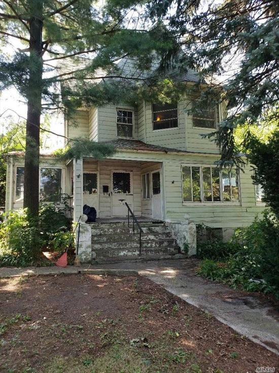 This is a huge house on a very large and rare lot. House needs a full gut renovation.