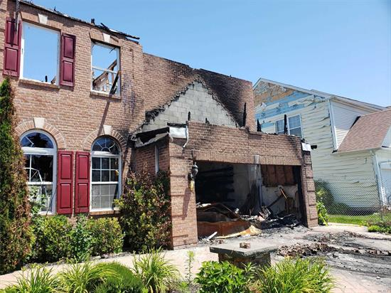 Severely fire damaged 4 bedroom 3 bath colonial. Located in the Villages of Mt Sinai. Come bring your creativity and turn this back into a home.