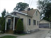 Cape Style Home w/Dormer North of 25A & Close to Town. Level Property, Approx 1/4 Acre with 3BRs, 2 Full Bths & a Detached 2 Car Garage w/2 Skylites. Maple Cabinets & Granite Counters, SS Stove & Dishwasher, Pantry Closet, Master BR can be Upstairs or Downstairs, Gas Stove & Dryer, Hi Hats, Fans, Full Basement. Wood & Ceramic Floors, Wood Doors, Roof & Cesspool (2005) Vinyl Siding, Slider to Spacious Fenced Yard, IG Sprinklers, Large Patio for Entertaining.