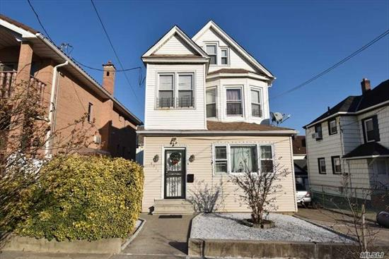 Detached 2 family.Private driveway. 8 bedrooms, 2 full baths. Wooden floors, tiled kitchen. Finished attic. Finished basement with laundry room and bathroom.