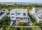 Pride Of Ownership Abounds In This Meticulously Maintained 2318 Sq Ft Home Loc, in Prestigious Oak Beach w Spectacular Views of Fire Island Inlet & Bay* Serenity Surrounds you while U Soak up the Sun at Near by Sandy Beach*LR w W/B FPL*Sun drenched Open Flr Plan*Hrdwd Flrs*Mstr Suite w fbth, w/i closet w Priv Deck w stunning Water views*Well Water W in House Filtration System*New Windws*Updated Heating**Txs to be grieved approx $3000k-2020 tx yr 50 Min.s From NYC & 20min to LIRR.* A MUST SEE!