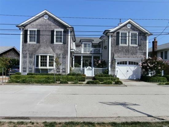 *Newer Cedar Beach Home, 285' to the Beach, 3 Levels, Double Lot, 4/5 bedrooms, 3 full Baths, Master Bedroom Suite with Full Lg Bath and walk-in Closet, Great Room, EIK, Dining room, Living room, Den, Oak floors, Plenty of closets, Utility room, Full Basement, Garage, rear Patio 70' x 15' with Barbecue & Cabana, Gas Radiant heat, Central Air, This is a Must See Beach Home!