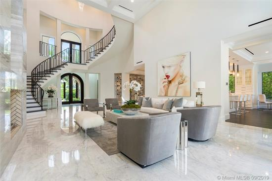 Come See The Difference Between This Quality New Custom Built Home Versus A Spec Home. Gated Waterfront Estate With 75' Waterfront, 3-Story Cbs, 5 Bedroom/5 Bathroom/1 Half Bathroom, Master Bedroom Suite On The 1St Floor And 2Nd Floor, Magnificent 3Rd Floor Bonus Room With Intracoastal Waterway Views, Elevator, Media Room, Floor To Ceiling Glass Wine Room, Floor To Ceiling Gas Fireplace, 36X36 Marble Throughout, 45X15 Salt/Heated Pool With (Gas) Fire And Water Features. New Concrete Dock/Pilings Extended To 11' From Seawall With New Coral Reef For Turtles And Sea-Life. Cell Phone Controlled Lighting/Smart Home, Hurricane Impact Windows And Doors, 3-Story Foyer With Spiral Italian Wood Staircase. Not A Detail Was Missed On This Custom Home! A Must See!