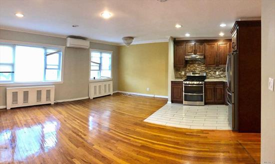 Renovated 2 Bedroom/ 1 Bathroom Apartment With Large Balcony On the 2nd Floor. It Features a Beautiful Kitchen With Cherry Wood Cabinets/ Stainless Steel Appliances, Large Living Room With Dining Area, , Hardwood Floors Throughout. Conveniently Close To Shops, Transport And Schools. Parking is Available.