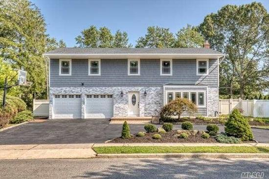 Magnificent Large Colonial In Top Rated Syosset School Disctrict On A Great & Spacious Size Property. Newly Done 5'' Oak Espresso Floors, Crown Molding,  New Windows And Doors. Wonderful Gourmet Custom Kitchen With Viking Appls and Quartz Counter Top. Come See What Everything This House Has To Offer W/ A Bright And Sunny Atrium and IG Pool. Call Today!