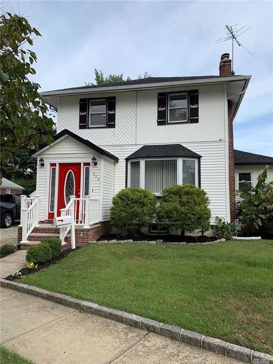 Charming side hall colonial. Park-like backyard, 135 ft deep. First floor features updated kitchen, Formal Dining Room, Office/Pantry, .5 Bath, Living Room w/ Wood Burning Fireplace. Second Floor includes 3 Bedrooms, Full Bath. Multi Car Driveway, Walk to LIRR & Village...