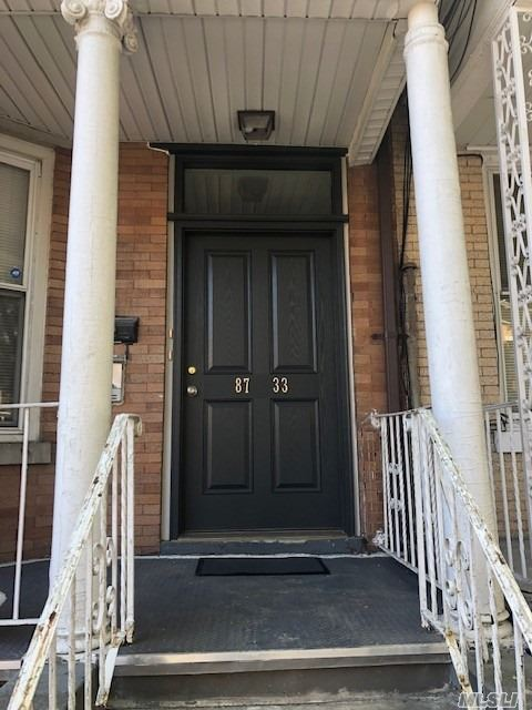 Sunny renovated first floor apartment,  New hardwood floors, ceiling fans, Modern and classic Eat in Kitchen and Full Bathroom, Large Living Room , 2 Master size bedrooms and a back Sun Room with access to the private yard.
