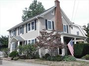 Charming Center Hall Colonial Just Listed W/large rooms, LR w/Fireplace, Eik, Fdr, Partial Fin Bsmt w/OSE, Huge attic area, Large 1.5 car garage, inviting rear yard W/stone paver patio. No flood insurance required.