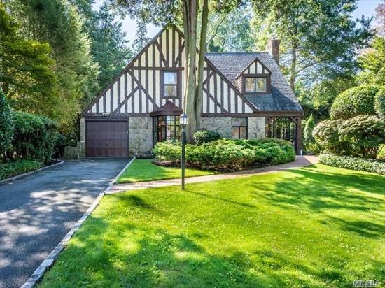 Classic South Strathmore Tudor on a quiet interior street. The heart of the home is the updated kitchen/family room with wood-burning fireplace, and mudroom. Beautiful cabinetry, countertops and high-end appliances. Formal living with fireplace and dining rooms. Master bedroom and newer mbath, 2 add'l bedrooms and newer hall bath.Legal finished basement, house generator