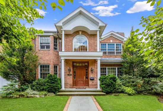 Welcome to this spectacular Brick colonial in NHP!This stunner has 5 over-sized brs & 5.5 baths.Modern EIK w/Commercial appliances, subzero refrigerator, granite counters, wine-cooler. Master bedroom upstairs has vanity bath & walk-in closet.Well-done living room, family room, attic.Full finished basement has a theater room. Radiant heated Hardwood floor, recessed lighting, Central AC, Gas heat.This house has it all. Fenced backyard w/patio & Ig granite pool. 2 space att parking. Must See to believe