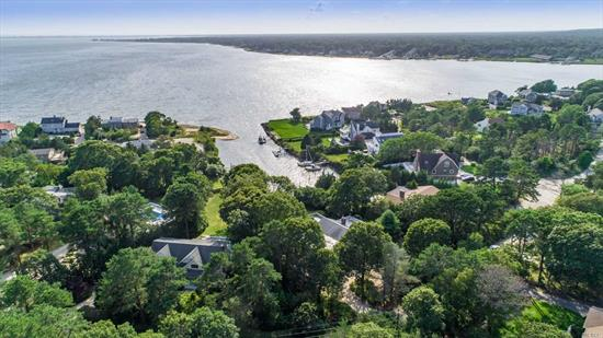 Waterfront home with beautiful sunset views with boat dock and gunite heated swimming pool in the desired Rampasture area. Enjoy large open floor plan with four bedrooms, three baths, eat in kitchen, formal dining room, massive living room with fireplace. All with panoramic views of Tiana bay. A diamond you won't want to miss.