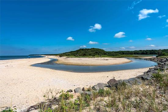 Situated directly across from Goldsmiths Inlet and miles of Long Island Sound beachfront, this home offers sweeping views of the sound and is a half mile from 60 sound front acres of nature trails in Peconic Dunes Park. The home is privately positioned on a double lot with an expansive rear deck and large, private and manicured back yard with 12 foot privet hedges to give privacy from neighbors. 3 bedrooms, 1.5 baths, full basement on 0.26 acres.