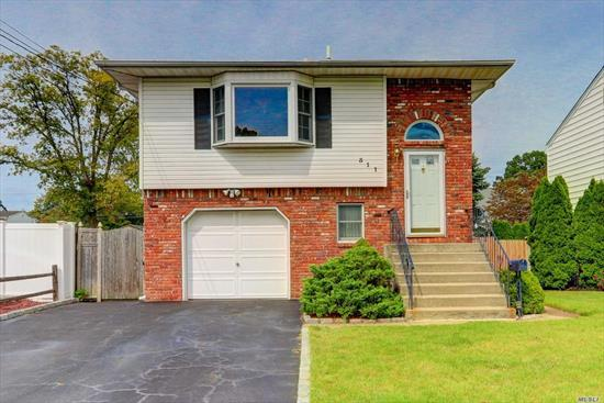 Beautiful Hi-Ranch, 4 Bedrooms, 2 Updated Baths, Lg Bright Eik/ W Skylight , Office, Den, Formal Dr, Cac, Rear Deck, Completely Fenced In, potential Mother/Daughter With Proper Permits.