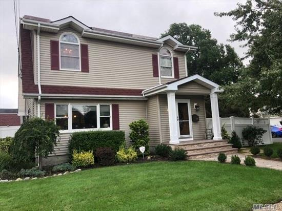 Gorgeous home! Beautiful expanded EIK w/ granite countertops & S/S appliances, hardwood floors, 6 panel doors, custom moldings, custom drapery, Andersen windows, FDR, ductless A/C, LR, mud room, office or 4th BR & newer bath. 2nd floor features 3 large BRS, vaulted ceilings, MBR w/ huge walk-in closet, newer Fbth. New front brick stoop & walkway, PVC fenced-in yard, professional manicured landscaping, backyard w/ large brick patio & 2 car garage.