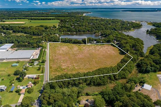 Imagine the possibilities! 15.2 acres of level land, approximately 300' of which are waterfront - on Deep Hole Creek, with R-80 zoning, (residential 2 acre), this property has the makings of either an extraordinary estate or possible subdivide - the choice is yours! Choose the North Fork today!