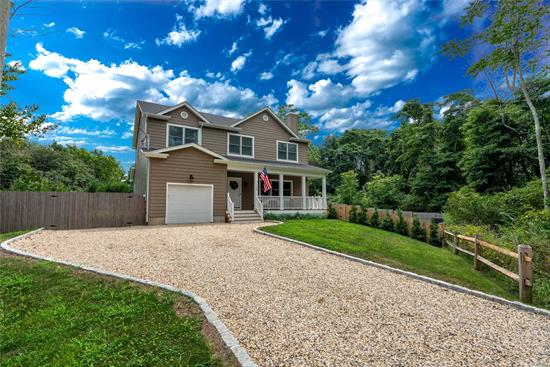 Built in 2016, Mint Condition W/ Deeded Beach Rights To Private Assoc. Sound Beach! Located Approx 1 Mile To Greenport Village & Nearest Winery. Open Floor Plan W/ 4Br/3.5Bath, First Floor Master Suite W/ Ensuite Bath Separated By Barn Door. Second floor master ensuite. Beautiful kitchen with granite & W/ Custom White Cabinets, Wood Burning Fireplace. Rocking Chair Porch. Huge Backyard W/ Extensive Landscaping. Custom Stone Patio & Gazebo. Room For Pool! 8Ft Ceilings In Full Basement.