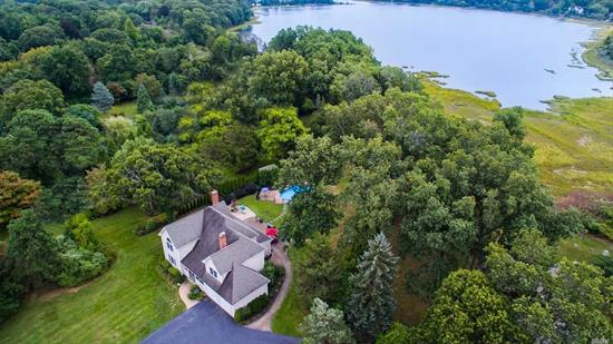 Incredible Waterfront Value! Gorgeous views from almost every room. Situated on over 1 acre of beautiful property with inground saltwater pool. Wood floors, central air, open floor plan. Taxes being professionally greived. Do not miss this opportunity!