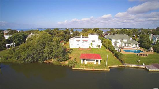 Havemeyer Mansion, one of 10 In Bayberry Point. On The Swimming Canal sits This Wonderful Moorish Style Home. 3 Stories 6 Brms 3. 5 Baths Boathouse, Gunite swimming pool, 2nd floor Master w/ front Veranda & Summer Sleeping Quarters. Association Bayfront beach. Needs complete renovation. Ready for your STAMP!! 150 X 316' Prop. over 1 Acre