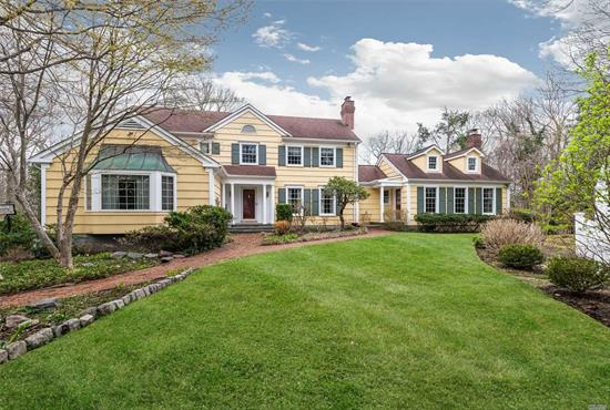 COLD SPRING HARBOR SD #2. Located one of the most picturesque streets and set on two park-like acres. This classic 5br Colonial presents a gracious floor plan for elegant living. The gourmet kitchen with large eating area opens to a comfortable den with fireplace. Large 1st floor Master bedroom suite, finished lower level. French doors across rear of house ope to brick patio & pool.