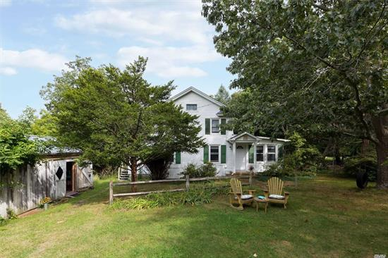 You'll find old world charm in this vintage renovated 1830 Farmhouse on 1.35 acres of natural wildlife habitat right in the heart of Southold Village. Large private property includes a 2 car garage and studio/barn. Both suitable for studios/offices or workshops. Take a 5 minute stroll down your country lane and you are in middle of downtown Southold Village. Zoned for Hamlet Business.