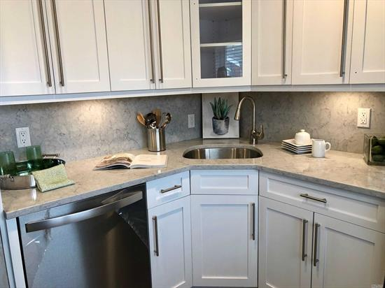Shaker-style kit/bath cabinets.Quartz ctrtop/backsplash/plank tile flr. Frmls shwr drs.subway tile bath/quartz vanity/basketweave flr tile.Hi-hats.Ceil fans.Whirlpool gold ser stls.stl.appl. WD.Gray paint/crpt.AC units.Club/Gym/Pool. Close to StonybrookU/Nicolls Rd/347/Patchogue/Sayville