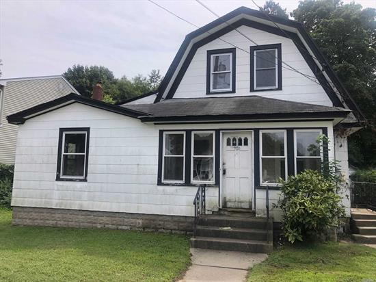 Two Story Colonial, Features 3 bedrooms, 2 Full Bathrooms, Kitchen, Lr, Dr, Enclosed Porch. Sits on Oversized Property on Quiet Residential Street. Great Opportunity, Close to Shopping, Parkways, LIRR, Area Beaches.