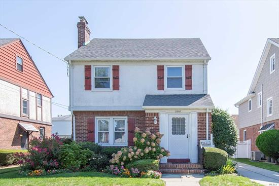 Lovely Colonial on a Charming Block featuring 3 bdrms, 1.5 Bths, Kitchen w/entrance to Bsmt, Formal Dining Room, Large living room w/wood fpl, Gleaming Hardwood flrs, 8-9ft ceilings, Updated Anderson Windows, Cozy den w/.5 bth w/ent. to yard, Oil heat but has gas meter, Radiator covers, New chimney insert within 3 years, 100 amp, Beautifully maintained Yard, Private Driveway,