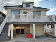 Bright, 3 bedroom apartment with front porch with bay views, E.I.K, full bath , private beach, garage, large side yard