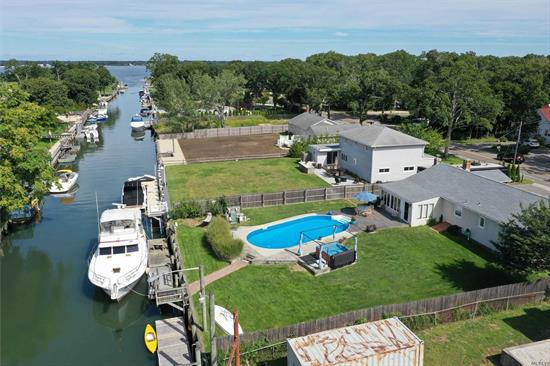 There is a resort-like atmosphere at this 3 bedroom, 1.5 baths, deep water, canal front ranch with inground pool. There is a large den with a ceramic tile floor and large picture windows and an office. Walk to a private beach. Bulkheaded. Easy boat access to the North and South forks and Shelter Island.