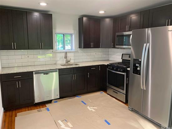 1st Floor Apartment Newly Renovated 2 Family Home. Ready to Move Right In! Main Floor Unit Has New Eat In Kitchen, 1.5 New Baths,  Large Outdoor Patio & Backyard. New Washer & Dryer In Unit. Large Garage Included. Close to Shops & Restaurants, LIRR, Fire Island Ferries and Major Roadways.