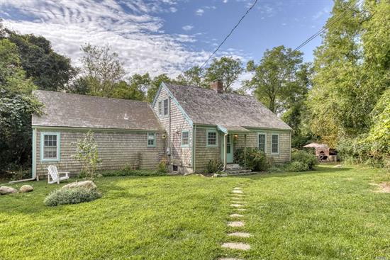 Authentic & charming 18th C home, c 1720. One of the first to be moved (by barge from Southold) to coveted Brown's Hill Association. Beautifully restored & maintained with original wide board floors, original exposed beams, 2 fireplaces, updated kitchen & baths, CAC, professional outdoor wood pizza oven, beautiful private back yard. ... & so much more. Deeded association Sound beach a short walk from the house.