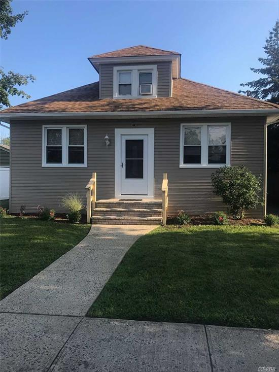 Spacious and sunny, Large Living Room and Dining Room, wood floors, office space, newly sided, 2 Bedrooms, street parking