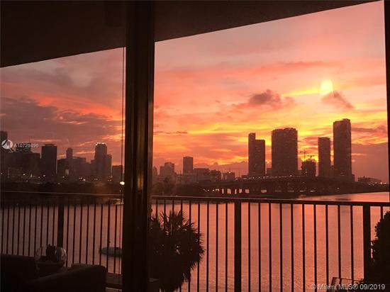 Unique Two-Story Corner Unit With A Million Dollar View Located In One Of The Most Exclusive Areas Of Miami And Miami Beach! 9.5' Walls Of Glass Opening Onto Huge Balconies On Each Level. Master Bedroom And Bathroom Are On Upper Level. Gorgeous View Of Downtown Miami. Unit Is Located On The Water Overlooking The Beautiful Dog Park And Intercoastal Waterway. Grey Hardwood Floors Downstairs And Polished Concrete Flooring Upstairs In Bedroom. Lots Of Mirrors That Reflect The Amazing View.  Custom Linen Curtains On All Windows, Remote-Control Black-Out Shades In Master Bedroom And Roll Down Window Shades Downstairs. Stunning Views And Even The Hallway To The Unit Has Floor To Ceiling Glass Walls. Kitchen Is Modern With All-White Cabinets And A Large Kitchen Island